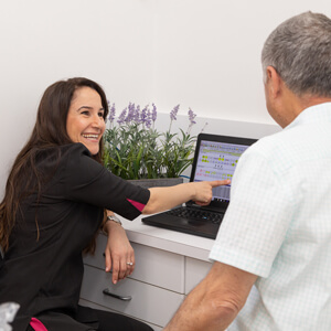 Dr Carmen consulting with patient