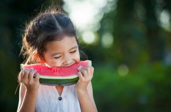 Girl eating watermelon.