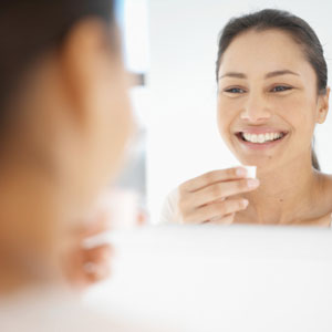 Woman smiling in mirror.