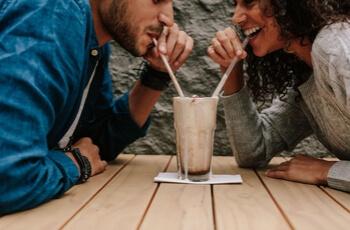 Couple drinking milkshake.
